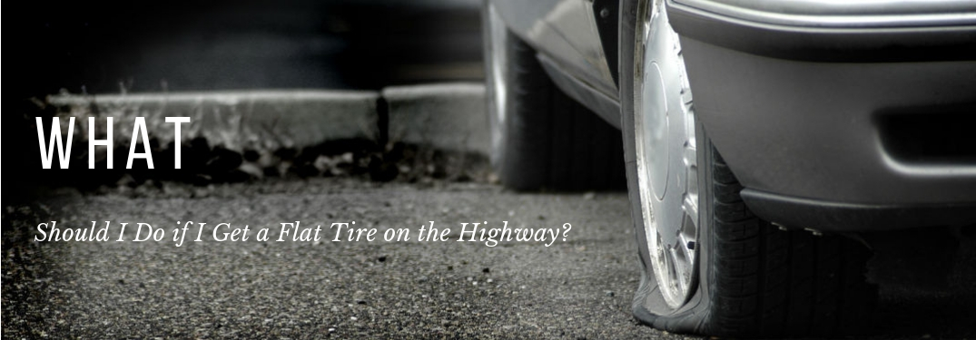 What Should I do IF I Get a Flat Tire on the Highway?, text on an image of a flat tire on the side of the road