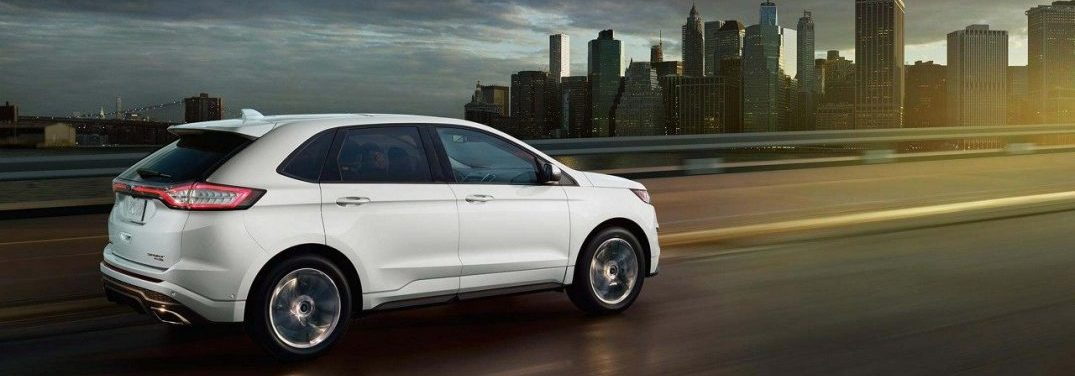 Ford Edge Driving On A Highway Towards A City