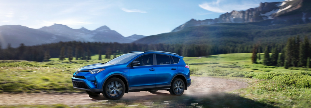 2018 RAV4 Hybrid in blue drives on country road