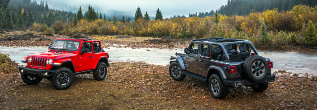 2 2018 Jeep Wranglers by a river