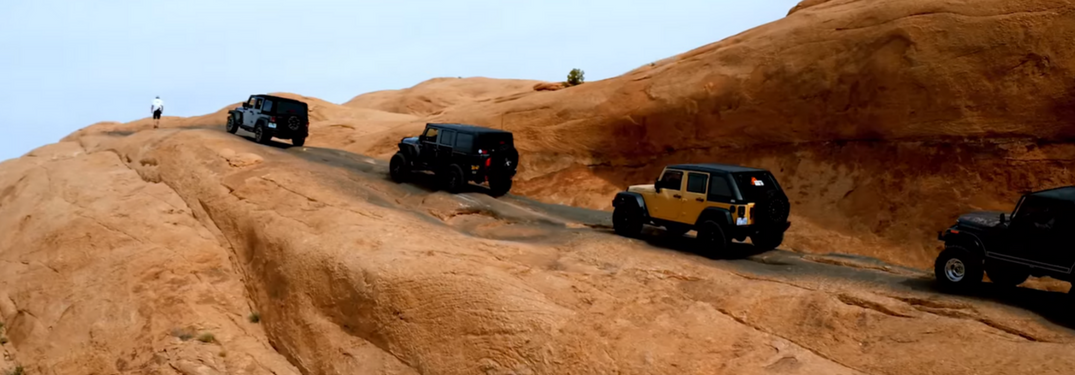 Jeeps drive a trail at the Moab Easter Jeep Safari