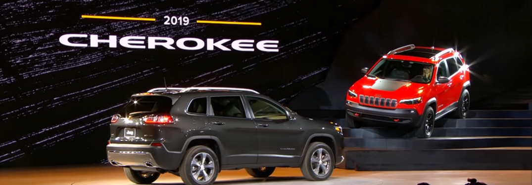Two 2019 Jeep Cherokees on stage at unveiling