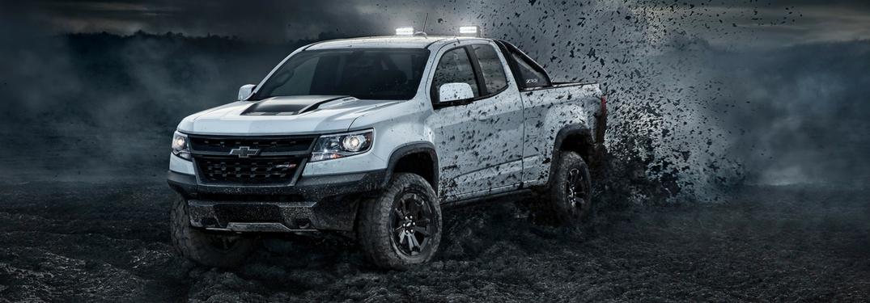 2018 Chevy Colorado ZR2 in white kicks up mud