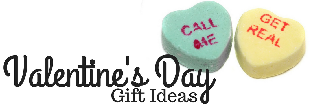 Valentine's Day gift ideas and two candy hearts