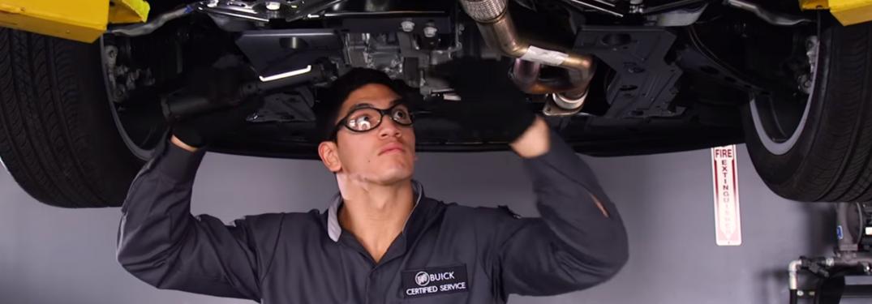 Certified Buick Technician checks under car