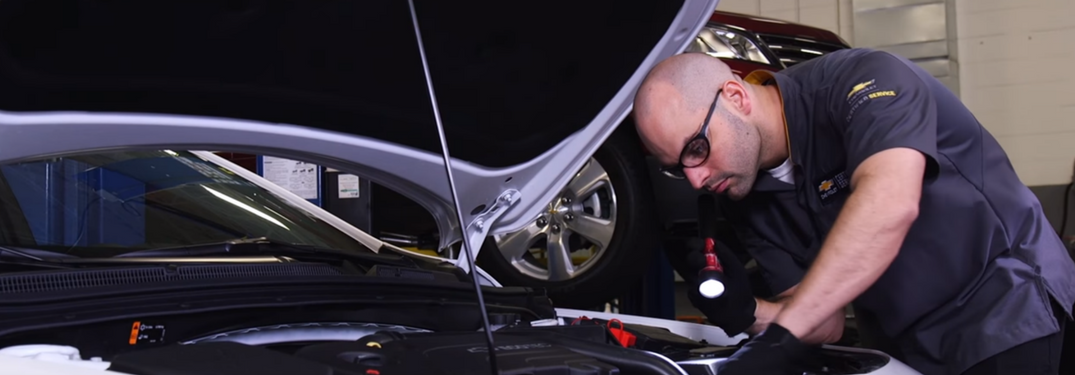 Technician Performs Chevy Certified Service