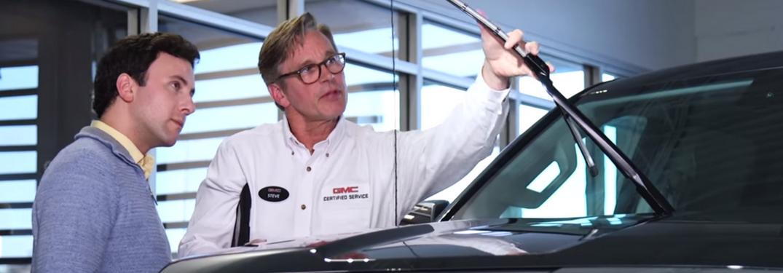 GMC ervice Technician shows driver windshield wiper wear