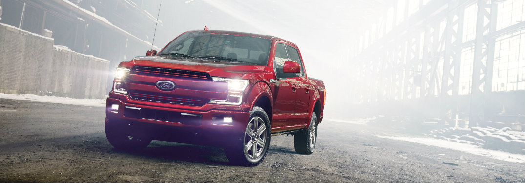 Red 2018 Ford F-150 on the road