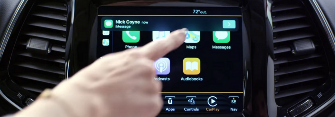 Screenshot of driver using Apple CarPlay in Jeep