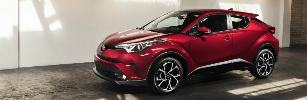 2018 Toyota C-HR red exterior shot concrete wall