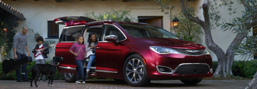 A family getting inside a 2018 Chrysler Pacifica