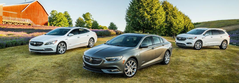 The Versatile 2019 Buick Regal Avenir parked next to the LaCrosse Avenir and Enclave Avenir