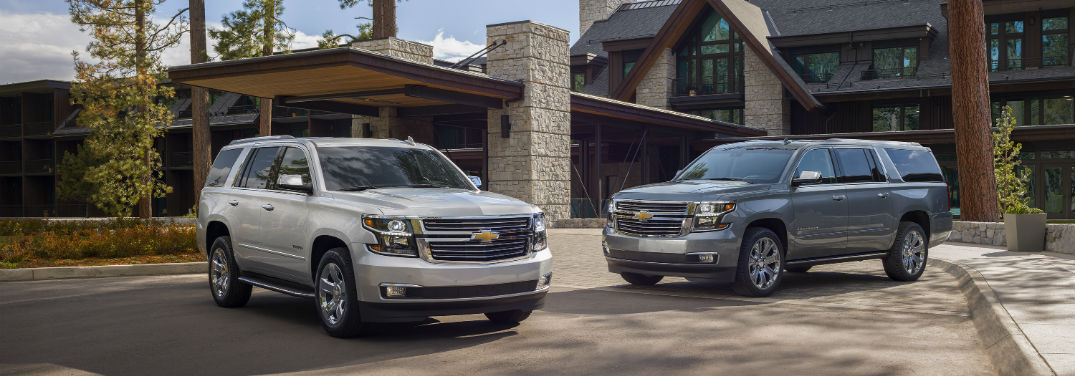 New 2019 Chevrolet Tahoe and Suburban Premier Plus Editions with image of 2019 Tahoe and 2019 Suburban parked in front of nice house