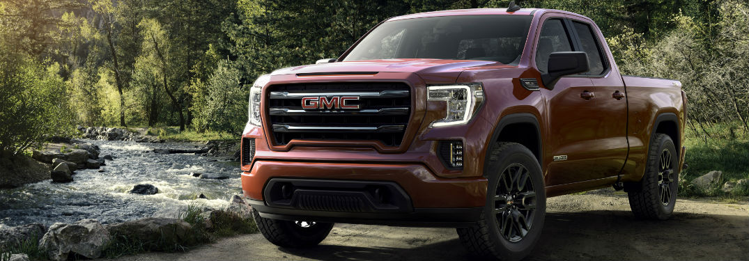 What's new for the 2019 GMC Sierra 1500? with image of 2019 GMC Sierra 1500 parked by a forest pond