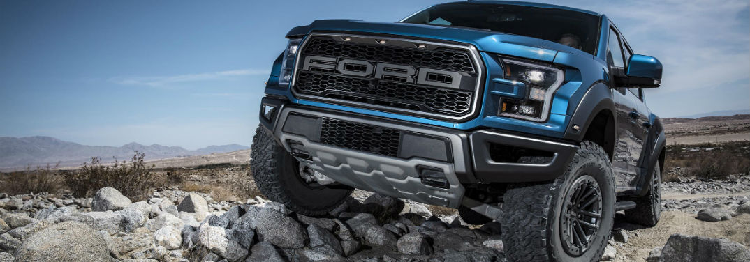 2019 Ford F-150 Raptor with Trail Control parked on uneven rocks