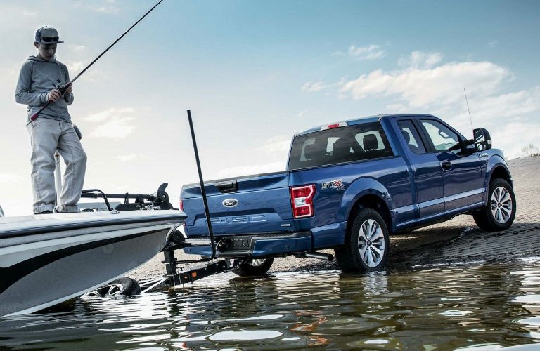 2019 Ford F-150 lowering a fishing boat into water