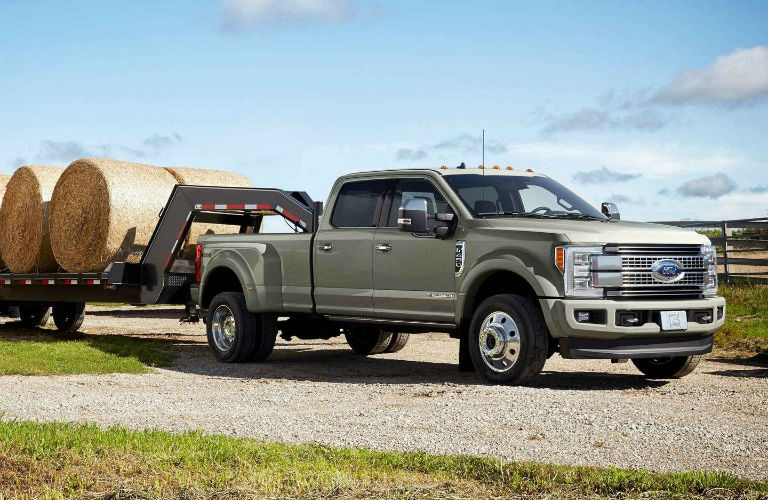 2019 Ford Super Duty towing trailer of hay bales