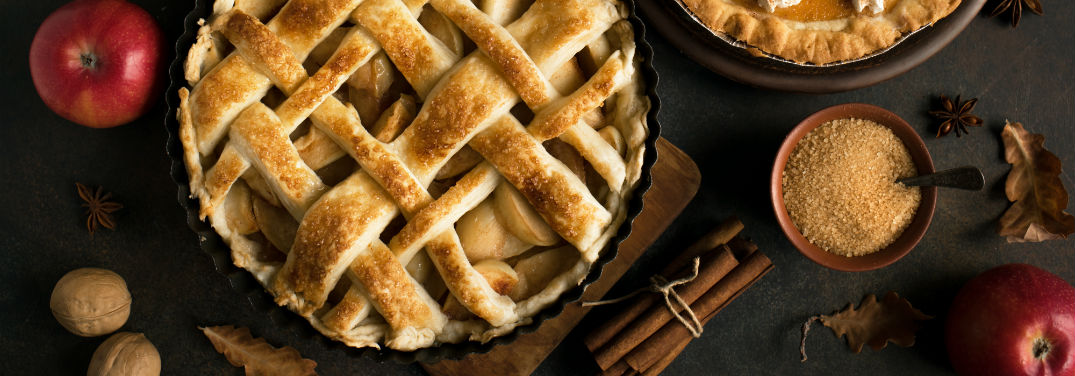 Top 6 Apple Pie Recipes with image of an apple pie and some apples near a pumpkin pie and some spice