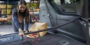 woman using the on-board vacuum in a 2019 Chrysler Pacifica Limited
