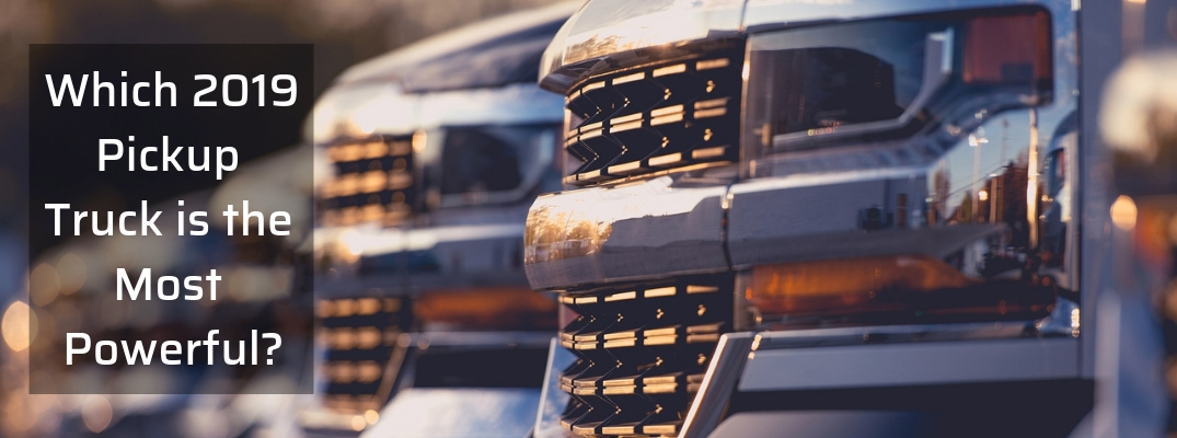 Closeup of truck grilles with Which 2019 Pickup Truck is the Most Powerful? white text