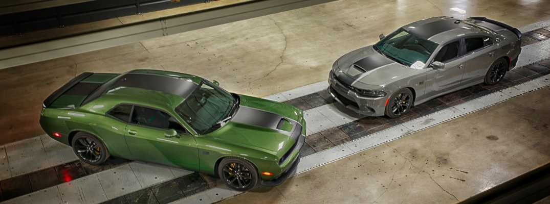 Overhead view of green Dodge Challenger Stars & Stripes Edition and grey Dodge Charger Stars & Stripes Edition
