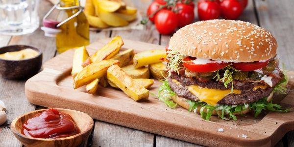 Burger and fries on cutting board