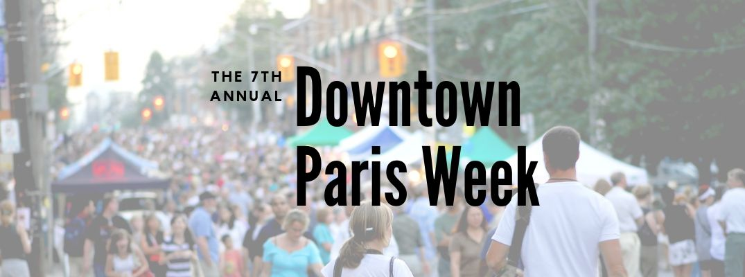 "Crowd of people with ""The 7th Annual Downtown Paris Week"" black text"