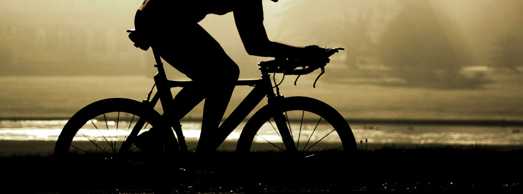 silhouette of bicyclist