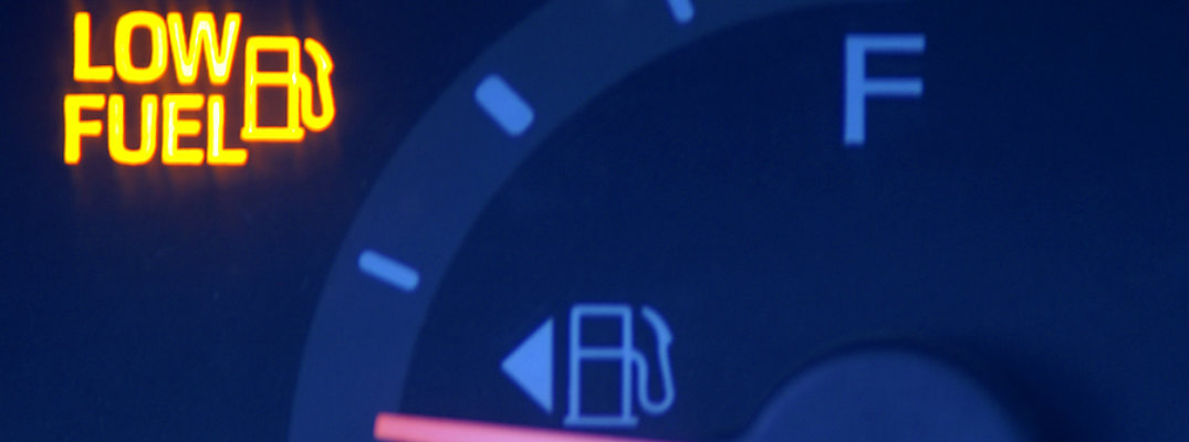 Picture of a gas gauge with the words low fuel