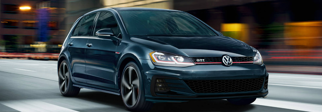 2018 Volkswagen Golf GTI driving down a street