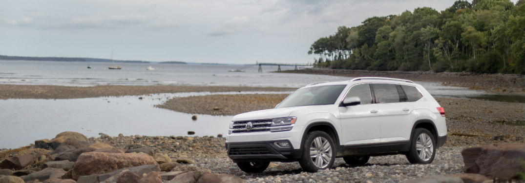 2018 Volkswagen Atlas parked on a lake's shore.