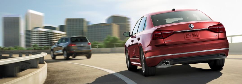 Two 2019 Volkswagen Passat models driving on a highway