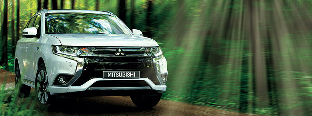 2018 Mitsubishi Outlander PHEV driving through a forest