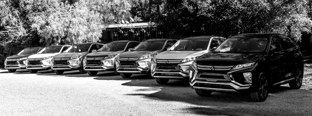Black & White image of several 2018 Mitsubishi Eclipse Cross models in a line