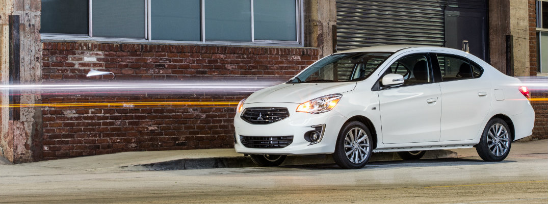 White 2018 Mitsubishi Mirage parked outside a city building