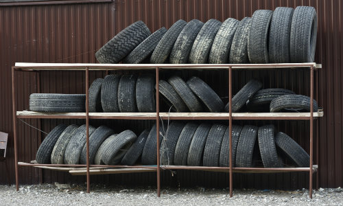 Old tires on a shelving unit