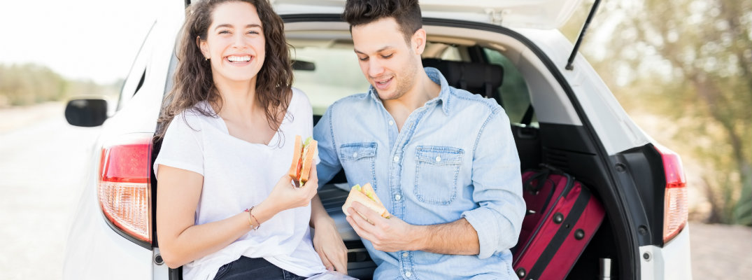 Car travelers eating in the back of a vehicle