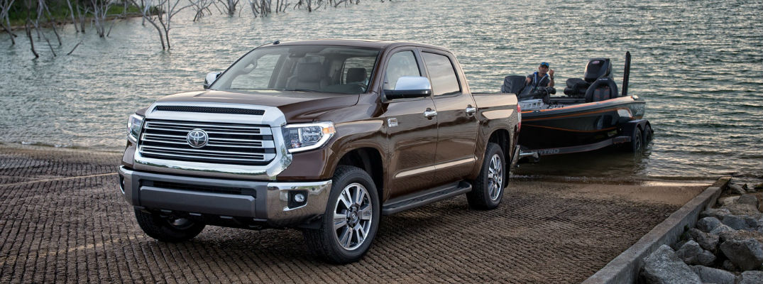 ... A Photo A Brown 2018 Toyota Tundra Pulling A Fishing Boat Out Of The  Water