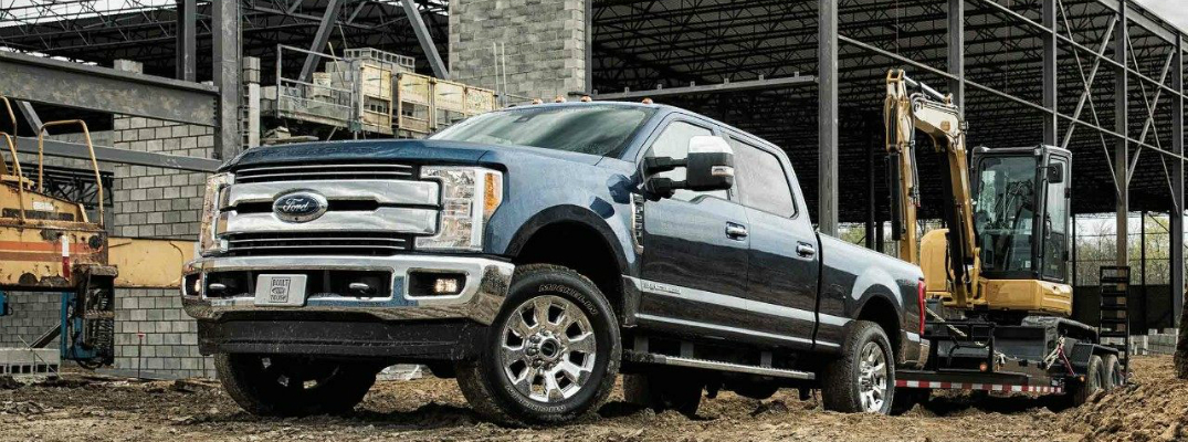 2018 Ford Super Duty Truck Towing a Backhoe