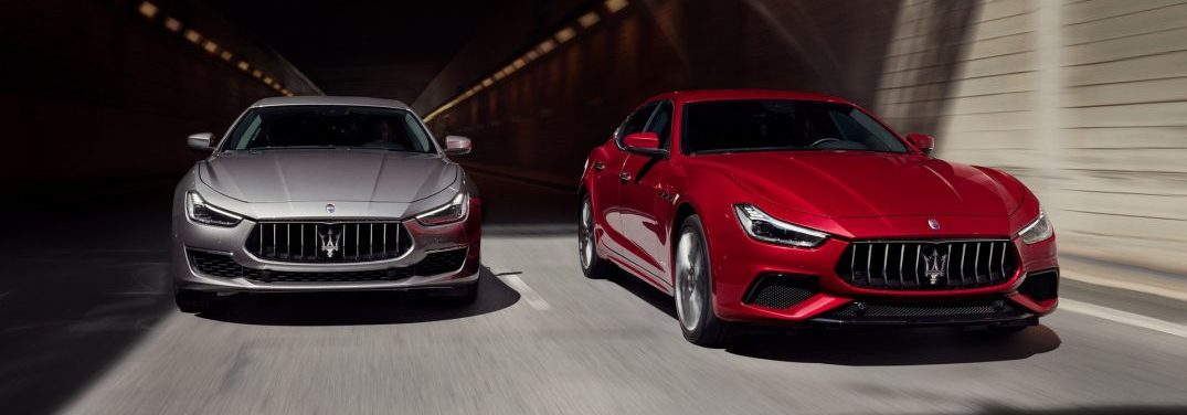 two 2019 maserati ghibli models driving next to each other