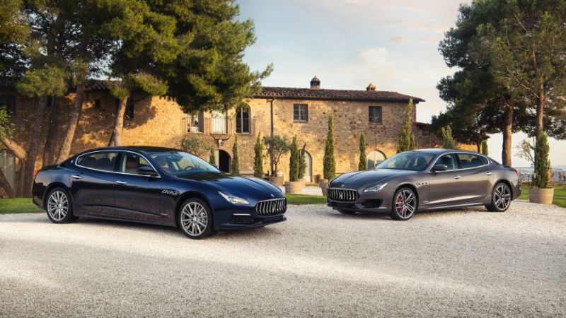 two maserati quattroporte models parked near each other