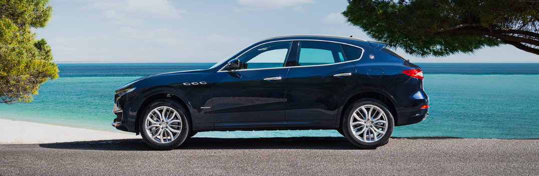 2019 Maserati Levante blue profile shot at beach
