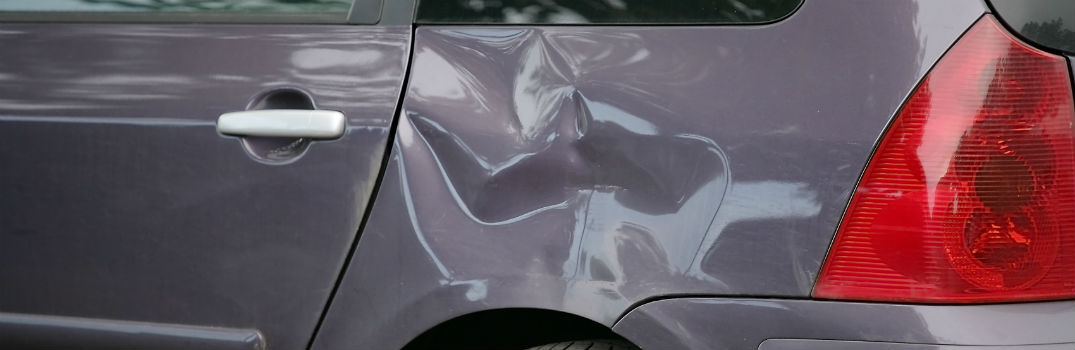 large dent in a generic vehicle