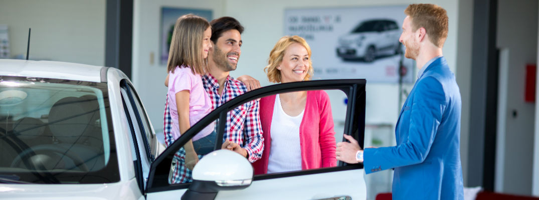 A car salesman talking to a family