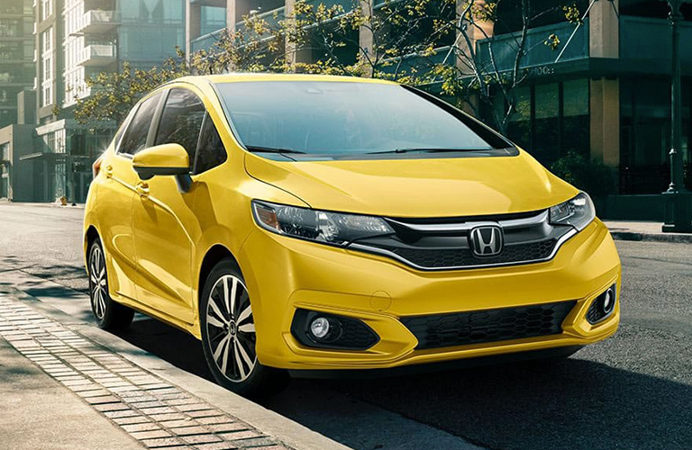 yellow 2019 Honda Fit parked by a curb
