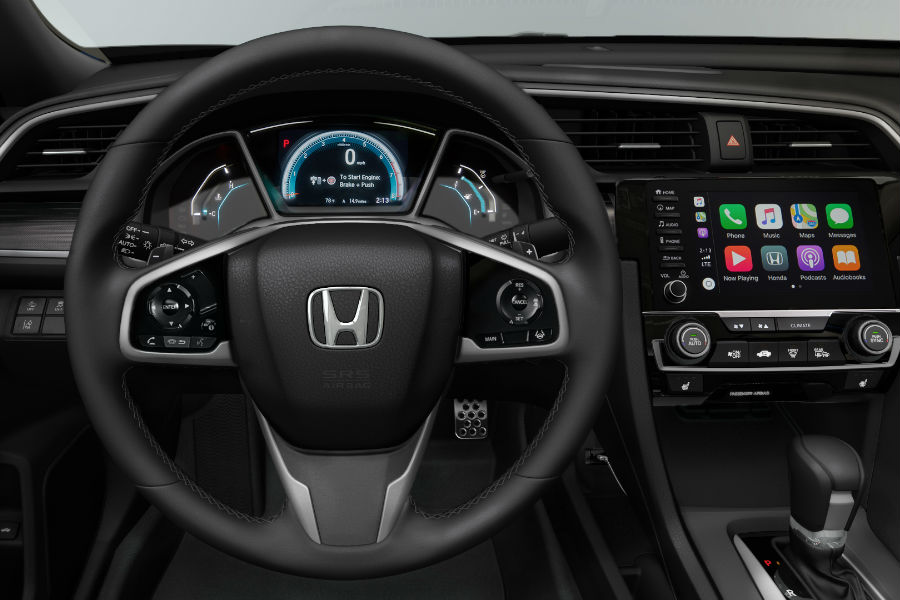A photo of the driver's cockpit in the 2019 Honda Civic Sport.