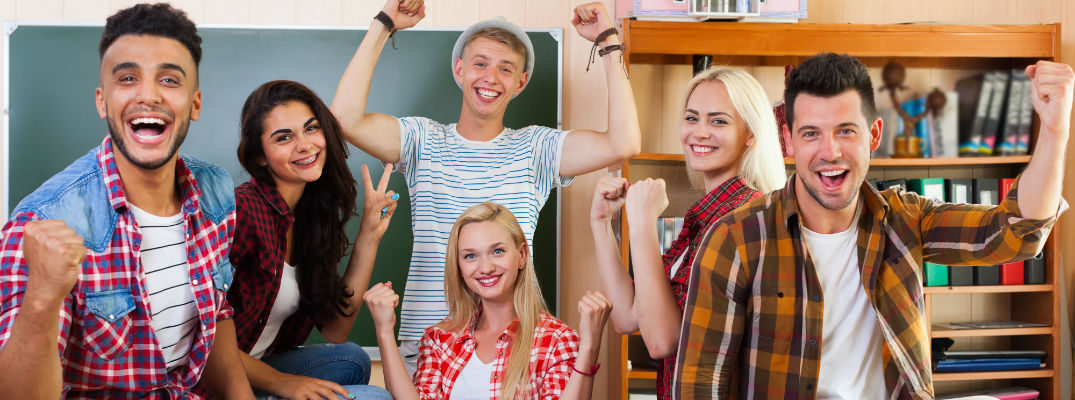A stock photo of happy college students in a classroom.