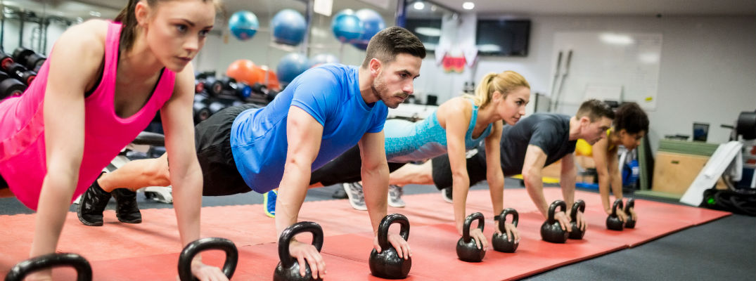 A stock photo of the people working out at a gym.