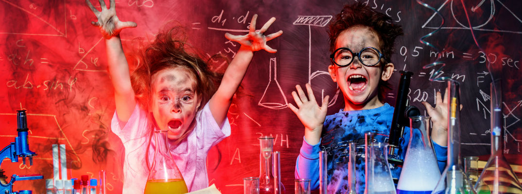 A stock photo of kids doing science experiments.