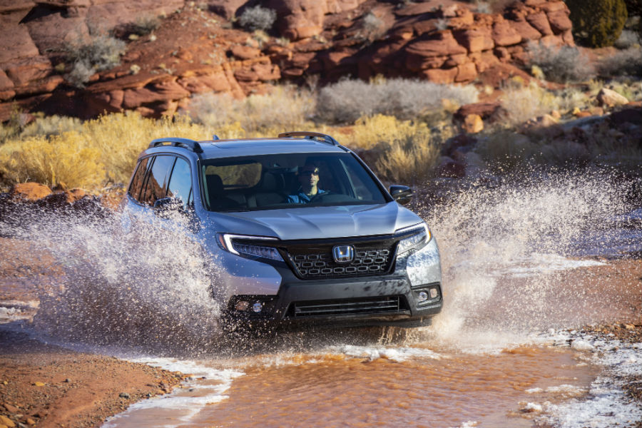A photo of the 2019 Honda Passport going through a large puddle.